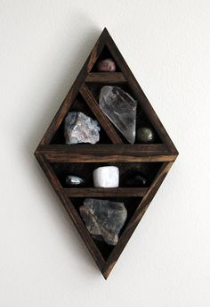 crystal and mineral stone collection in handmade geometric diamond wood curio shelf