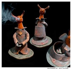 """This is an early high fire ceramic incense burner, """"Mother Singer"""". The smoke comes out of the mouth on one side, the eyes on the other and also down the sleeves."""