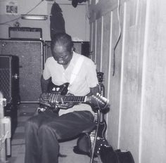 The great Hound Dog Taylor with his signature guitar at Ma Bea's in Chicago, 1971.....