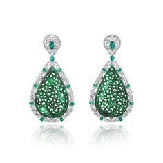 Chopard earrings in white gold, with two carved jadeites weighing a total of 45cts, pear-shaped emeralds and diamonds (POA).
