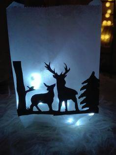 Peurat siluetti paperipussiin ja led valot sisään