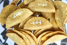 sour cream piped on tacos to make little footballs