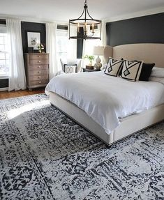 We finally found a large rug that worked in our master bedroom and are loving it! It's from and I love the… bedroom decor 40 Dreamy Master Bedroom Ideas and Designs — RenoGuide - Australian Renovation Ideas and Inspiration Master Bedroom Design, Dream Bedroom, Home Bedroom, Bedroom Rugs, Bedroom Designs, Dark Master Bedroom, Girls Bedroom, Modern Bedroom, Wall Decor Master Bedroom