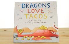dragons love tacos. by Adam Rubin. In case you didn't know, the best way to befriend a dragon is to throw a taco party.