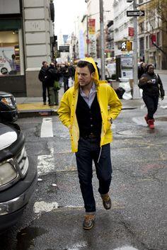 yellow rain slicker, jeans, navy cardi, blue oxford shirt, and LL Bean Rubber Moc Rain Boots in tan/brown