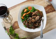 Grass-Fed Beef Bourguignon with Peas & Carrots —  Sure our Beef Bourguignon is healthy, but it could also hold its own at any 5 Star Restaurant!  The chefs use the best cuts of grass-fed beef, make a stock from scratch and add just the right amount of red wine to create this amazing entree!  Most importantly, this dish has all of the nutritional qualities that we look for:  - High in quality protein - High in omega 3 - High in antioxidants - Low glycemic load