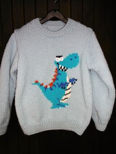 Child's sweater pattern dinosaur handmade from 2 years to 7 years in my shop wool, polyamide worsted wool acrylic machine washable in machine 30 ° C Creative model Animal Knitting Patterns, Order Checks, Sweater Jacket, Pulls, Knitting Projects, Superman, Hand Knitting, Christmas Sweaters, Creations