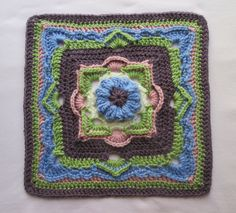 I designed this square to be used as a 6 or 12 inch square using eight colours.
