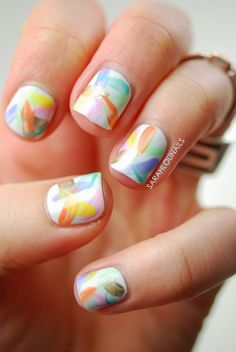 Nothing like a classic clean looking watercolor nail art. Use a white base color to show off the light watercolor style strokes on your nails.  source
