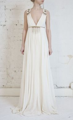 Deep V, a-line, grecian style Nicole Miller Dress. Comes with NM garment bag.   Authentic Nicole Miller dress - very beautiful.  Retails for $2000 - I paid 400 from a bridal boutique clearance, but the style does not suit me my figure.    I will consider all offers.