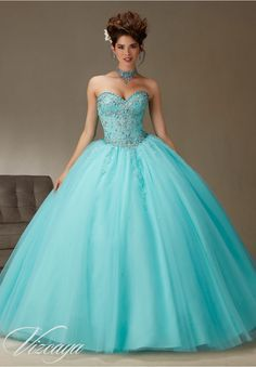 Quinceanera dresses by Vizcaya Tulle Ball Gown with Beading Matching Bolero Jacket included. Colors: Coral, Aqua, Cotton Candy, White.