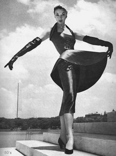 Jean Patchett models a Jo Copeland Bronze green, silk satin sheath dress, with bas-relief Jet embroidery and matching gloves. ( circa 1954 ) Photographed on the steps of the Thomas Jefferson memorial, Washington, for the Julius Garfinckel department store.  Modelled by the famous fifties fashion Icon, Jean Patchett.  I now think that this picture was almost certainly taken by Toni Frissel.