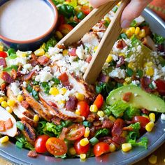 1 pound boneless skinless chicken breast 1 packet Taco Seasoning 2 heads romaine lettuce 1 pint grape or cherry tomatoes, halved 2 avocados, peeled and sliced 1 cup fresh corn kernels 1 bunch green onions, chopped 1/2 cup crumbled queso fresco cheese 1 cup dressing of choice 1/2 cup fresh…