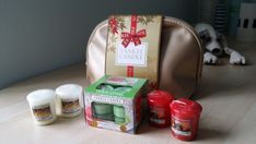 New. Yankee Candle Gift Set: 4 candles + 12 tealights + washbag. Unwanted gift.