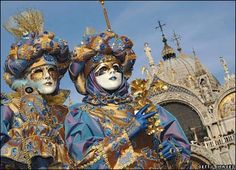 Masked participants stand in St. Mark's Square during the Carnival festivities in Venice, Italy. Carnival traditionally commemorates the passing of winter, with parties, costumes and balls, in the run-up to the Christian observation of Lent. Venice Carnival Costumes, Venetian Carnival Masks, Carnival Of Venice, Clowns, Pictures Of Venice, Culture Of Italy, Venice Mask, Beautiful Mask, Mardi Gras