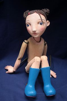 Girl rod puppet carved by Jan Zalud for The Little Angel Theatre