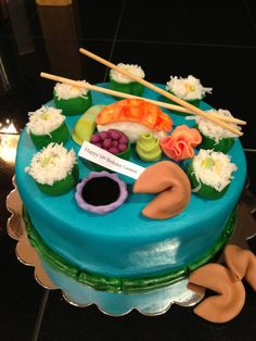 "Sushi Cake - 8 inch round covered in smoothed buttercream. I used coconut as the ""rice""."