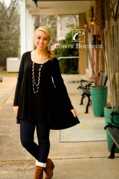 We love this classy black tunic! Dress it up with some of our pearls and you are ready to go! Call 601.591.4111 to order! We are open until 6pm! :)