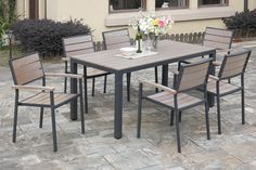 Eat and drink in style with this 7-piece patio set that includes an aluminum rectangle  shaped table with a sleek countertop. Set also includes six ultra luxurious chairs cushion in durable resin wood and seat frame. Each piece is covered in aluminum and resin wood rust-free with material that is also weather, fade, and heat resistant.