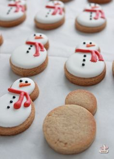 Smart: Use 2 different size round cookie cutters to make mini snowman and penguin cookies (Sweetopia).