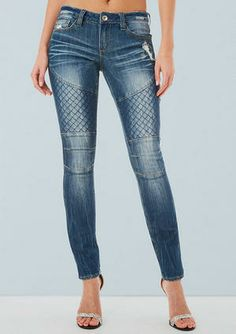 Stretch low-rise moto jean with back patch pockets.