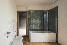 Image 39 of 49 from gallery of New Regolo Quarter / Atelier(s) Alfonso Femia. Photograph by Luc Boegly Alessi, Bathtub, Wall Decor, Bathroom, Gallery, Interior, Modern, House, Draco
