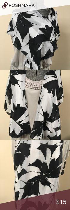 Black and White Flowered Scarf Lovely black and white flowered scarf.  Measures approximately 11-1/4x55. Accessories Scarves & Wraps