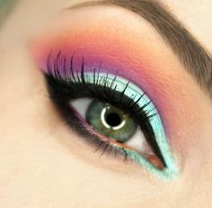 pretty makeup, I could try it with maybe a gold or more yellow-based green on the lid.. icy cool colors don't suit me