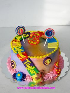 Candyland with rainbow swirl cake inside