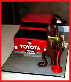 Monkey and red Toyota (customers business logo) cake by Sugarpie & Honeycrumbs