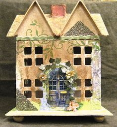 Here is a paper mache Victorian House I made for a Christmas gift. I had so much fun with it...now I need to make one for myself...I plan to...