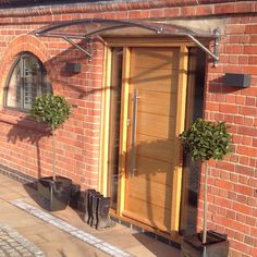 Stunning property with one of our arched door canopies made to fit the impressive entrance door. Canopy hand made from 316 Marine Grade Stainless Steel with long lasting polycarbonate sheet for years of protection from the elements. Arched Front Door, Front Door Canopy, Porch Canopy, Awning Canopy, Arched Doors, Porch Awning, Front Porch, Canopy Glass, Home Exterior Makeover