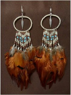 """Handmade feather earrings made by """"Delilah Sieraden Boutique"""""""