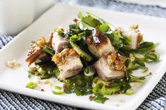 Lighten up crispy-skinned pork belly by serving with a Thai salad, tangy with lime and lush with herbs.