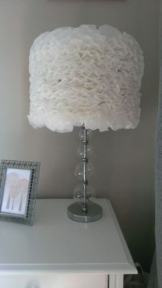Old lamp shade covered in coffee filters....fold coffee filters in half twice and bend down tip and hot glue to lamp shade
