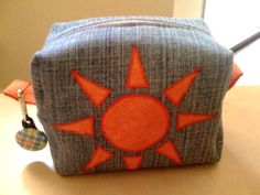 Mini pouch made with an old pair of jeans and handmade applique