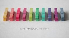 Stained clothes pins with vinegar, food coloring and water.