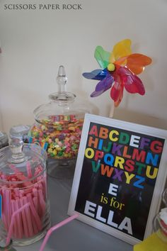 Love everything about this party...the rainbow cookie favors, framed decoration thingys, the cake...everything...
