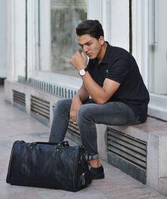 Black leather holdall for men.