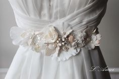Ornately Decorated Starfish and Seashell Beach Wedding Sash Bridal Belt on Embroidered Lace Flower Underlay by LAmei on Etsy https://www.etsy.com/listing/216981545/ornately-decorated-starfish-and-seashell