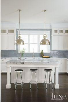 Stainless. Blue .White. Lighting. Tile backsplash. Thick marble counter.