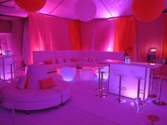 Sweet Caroline themed Bat Mitzvah in fuchsia, violet, orange. Hanging round balloons, illuminated bar, uplighting.  Also perfect for a Sweet Sixteen! By Diana Gould Ltd.