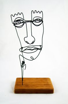 Wire Portrait--this is not vintage but it would blend well with Mid-Century.
