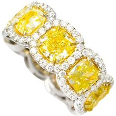For Sale on 1stdibs - Magnificent Fancy Yellow diamond eternity band, features 9.50 Carats of Fancy Yellow Cushion Cut Diamonds, surrounded by 1.50 Carats of w…