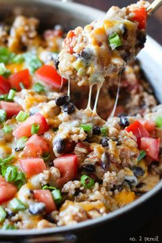 One-Pan Chicken Burrito Bowls.. 1 pound boneless, skinless chicken breasts, diced into bite sized pieces 3 tablespoon of olive oil 1/4 cup of diced yellow onion 1 cup of uncooked extra-long grain rice 1 14.5 oz can of diced tomatoes, drained 1 15oz can of black beans, drained and rinsed 1/2 teaspoon of garlic powder 1/2 teaspoon of chili powder 1 teaspoon of cumin 2 1/2 cups of low-sodium chicken broth 2 cups of colby jack, monterey jack or cheddar cheese