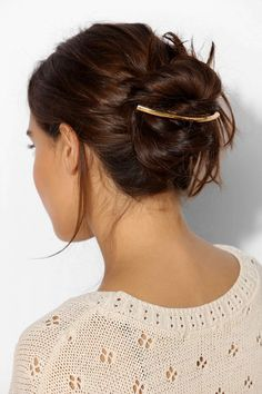 Curved Metal Barrette over messy bun