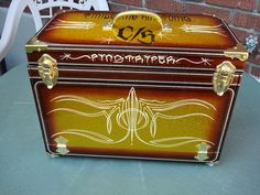 My metal flaked and candied pinstripe box,paint and flake by blue moon kustoms-pinstriping and lettering by me