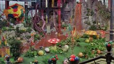 Cake designer Rosalind Miller created an edible garden that will remind you of 'Willy Wonka and The Chocolate Factory'. Willy Wonka Factory, Wonka Chocolate Factory, Candy Room, Candy Factory, Trunk Or Treat, Candyland, At Least, Backdrops, Backdrop Ideas