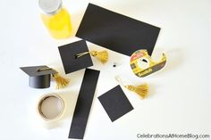 """bottle toppers- 1-2"""" strip blcak scrapbook paper (not CS), square 2-2 1/2"""", doouble sided tape, glue dots- 2 each to hold top to cylinder sides of cap. Hold tassel  on with brad"""