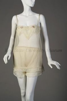 """1920s Off-white chiffon with floral lace trim CAMISOLE and PANTIES. """"The long drawers of the 19th and early 20th centuries gave way to panties as skirts shortened. Although some drawers were stitched together, most had been split without a crotch seam. Some panties in the 1920s had the front and back panels joined only by a narrow ribbon."""" (Undress guide copy, 9/2012)"""